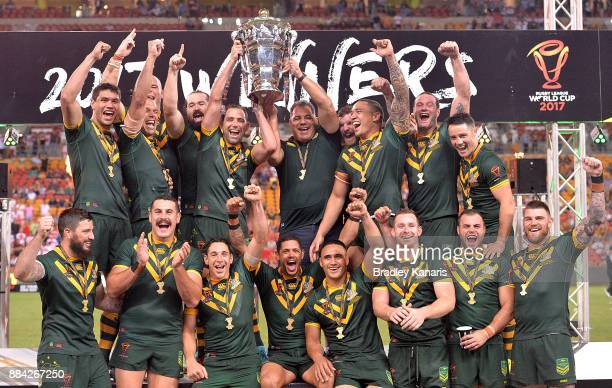 The Australian Kangaroos celebrate victory as captain Cameron Smith holds up the world cup trophy after the 2017 Rugby League World Cup Final between...
