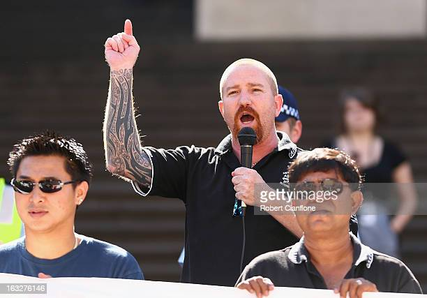 The Australian Manufacturing Workers Union's assistant secretary Leigh Diehm talks to protesters on the steps of State Parliament during a union...