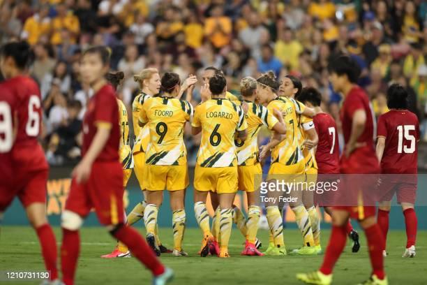 The Australian Matildas celebrate a goal during the Women's Olympic Football Tournament PlayOff match between the Australian Matildas and Vietnam at...