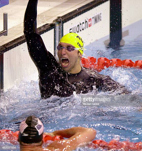 The Australian men's swim team anchor swimmer Ian Thorpe reacts after his team sets a world record in the 4x100meter freestyle relay with a time of...