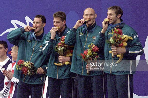 The Australian men's swimming team celebrates with their gold medals September 19 2000 after victory in the Men's 4 x 200m Freestyle Relay Final that...