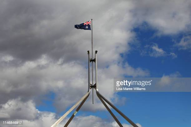 The Australian national flag is seen flying at Parliament House on May 04 2019 in Canberra Australia Australians will head to the polls on May 18 to...