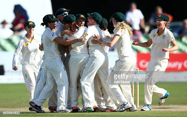 The Australian players celebrate as Sarah Coyte of Australia claims the final wicket of Anya Shrubsole of England to win the match during day four of...