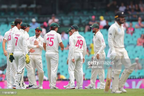 The Australian players celebrate the wicket of New Zealands Tom Blundell during the fourth day of the third cricket Test match between Australia and...