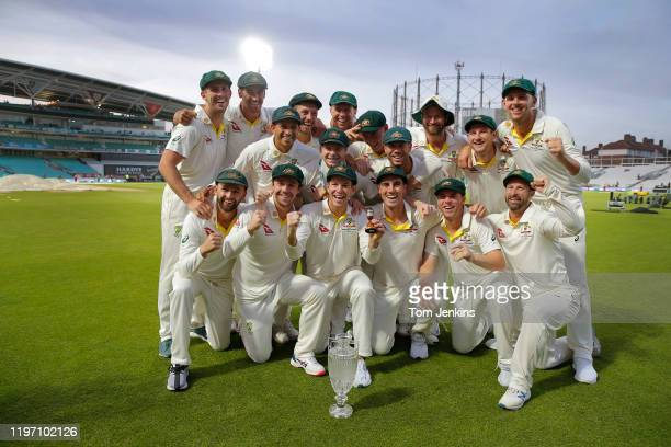 The Australian players celebrate with the Ashes urn after the presentation ceremony after the match during day four of the England v Australia 5th...
