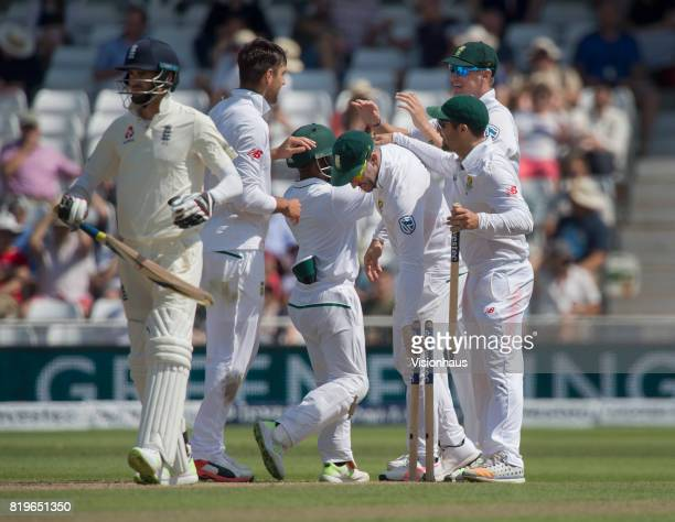 The Australian players collect the stumps as souvenirs after beating England on the fourth day of the second test between England and South Africa at...