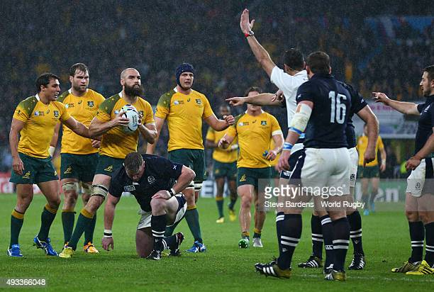 The Australian players look on as the Referee Craig Joubert awards Australia a late match winning penalty during the 2015 Rugby World Cup Quarter...