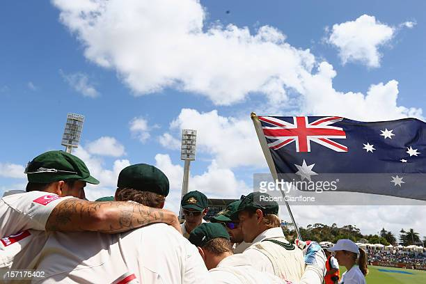 The Australian players prepare to start play during day one of the Third Test Match between Australia and South Africa at the WACA on November 30...