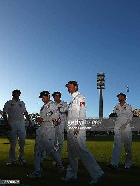 The Australian players walk from the ground after day two of the Third Test Match between Australia and South Africa at WACA on December 1 2012 in...