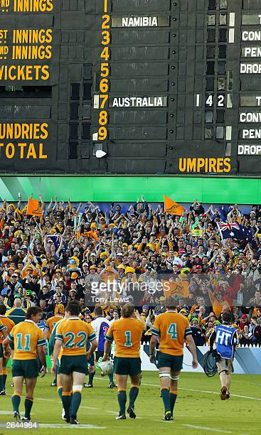The Australian players walk up the ground to the crowd's applause as the scoreboard shows their142-0 score, a record World Cup margin, after the...