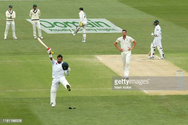 The Australian players watch on as Yasir Shah of Pakistan celebrates his century during day three of the 2nd Domain Test between Australia and...