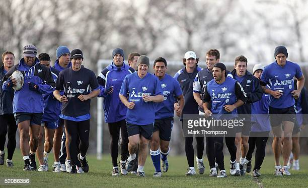 The Australian Rugby League team the Canterbury Bulldogs warm up during a training session at Leeds Met University's sports complex on January 31...