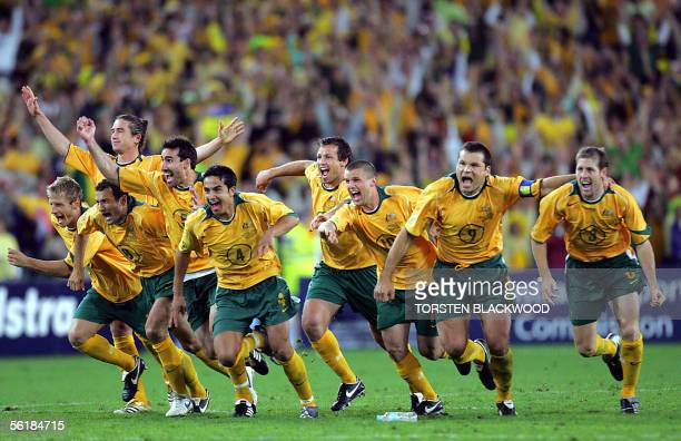 The Australian Socceroos jubilate after defeating Uruguay in the FIFA World Cup qualifier at Stadium Australia in Sydney 16 November 2005 Australia...