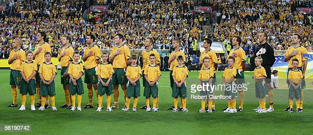 The Australian Socceroos line up to sing the national anthem prior to the second leg of the 2006 FIFA World Cup qualifying match between Australia...
