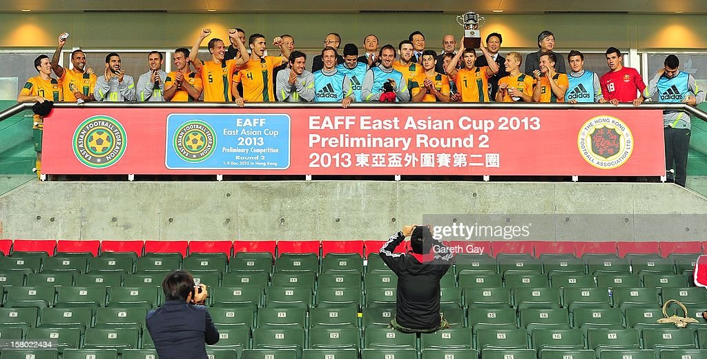 The Australian Socceroos squad celebrate with the trophy after the EAFF East Asian Cup 2013 Qualifying match between Chinese Tapei and the Australian Socceroos at Hong Kong Stadium on December 9, 2012 in So Kon Po, Hong Kong.