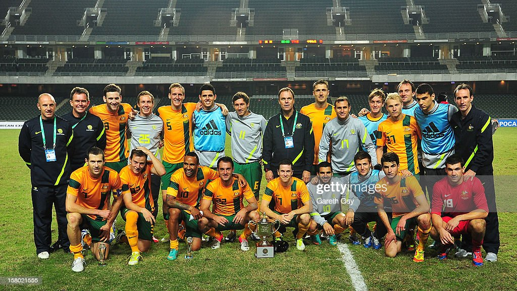 The Australian Socceroos squad pose with the trophy after victory in the EAFF East Asian Cup 2013 Qualifying match between Chinese Tapei and the Australian Socceroos at Hong Kong Stadium on December 9, 2012 in So Kon Po, Hong Kong.