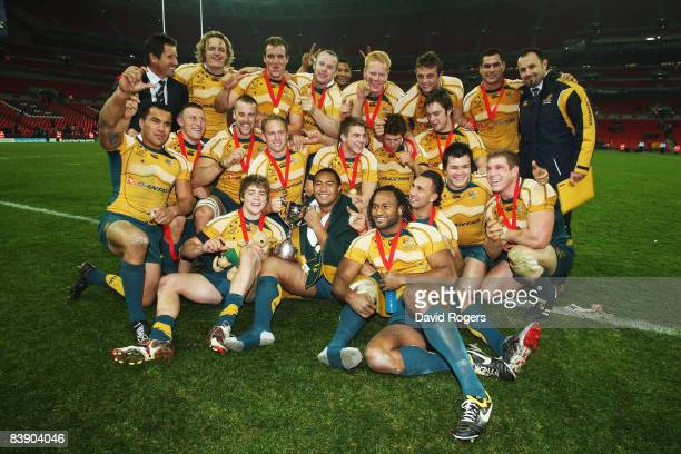 The Australian squad and coaches celebrate following their team's victory during the 1908 2008 London Olympic Centenary match between The Barbarians...