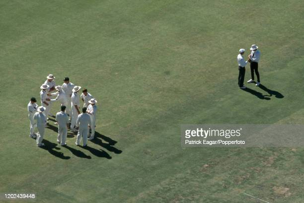 The Australian team and umpires wait for the incoming England batsman during the 5th Test match between Australia and England at the WACA Perth...