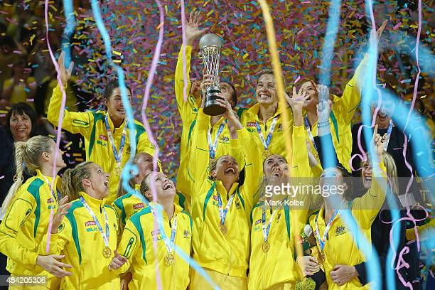 The Australian team are covered with confetti as they celebrate with the trophy after victory during the 2015 Netball World Cup Gold Medal match...