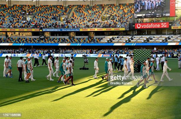 The Australian team are seen leaving the field after losing the series on day five of the 4th Test Match in the series between Australia and India at...