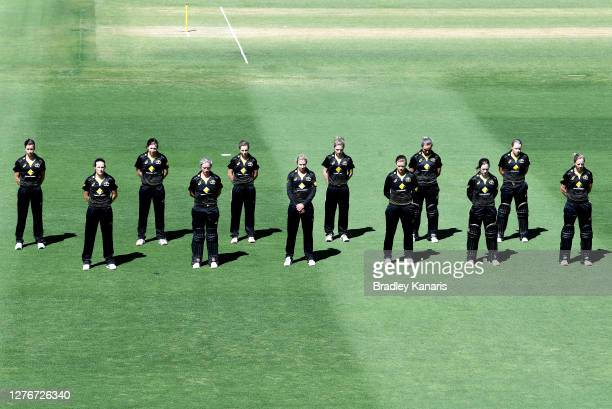 The Australian team are seen paying their respects during a one minute silence in honour of Dean Jones before game one of the T20 Women's...