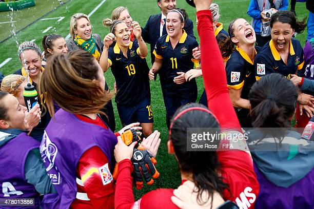The Australian team celebrate after beating Brazil in the FIFA Women's World Cup 2015 Round of 16 match between Brazil and Australia at Moncton...