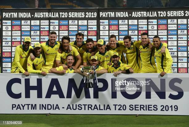 The Australian team celebrate after they defeated India to win the series during game two of the T20I Series between India and Australia at M...