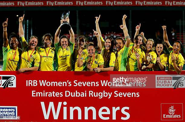 The Australian team celebrate after winning the IRB Womens's Sevens World Series Cup Final during the Dubai Sevens the second round of the HSBC...
