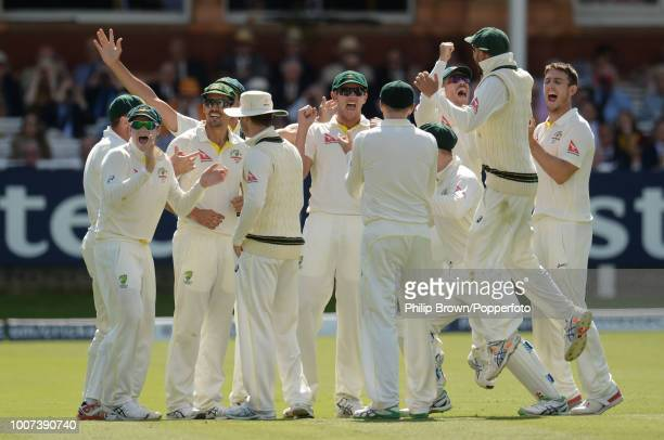 The Australian team celebrate as the run out of England's Ben Stokes by Mitchell Johnson is confirmed during the 2nd Ashes Test match between England...