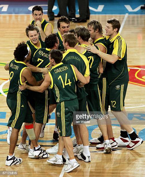 The Australian team celebrate victory after the men's gold medal basketball game between Australia and New Zealand at the Melbourne Park Multi...
