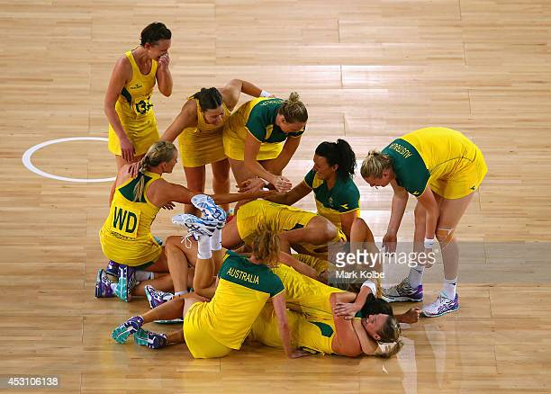 The Australian team celebrate victory during the Netball Gold Medal match between New Zealand and Australia at SECC Precinct during day eleven of the...