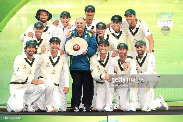 The Australian team celebrate victory with the trophy after day four of the Second Test match in the series between Australia and Pakistan at...