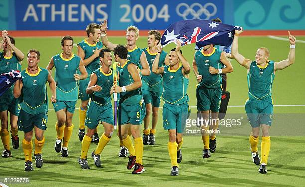 The Australian team celebrate winning gold in the men's field hockey gold medal match against the Netherlands on August 27, 2004 during the Athens...