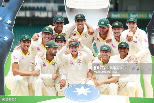 The Australian team celebrate winning the Ashes series with a replica urn during day five of the Fifth Test match in the 2017/18 Ashes Series between...