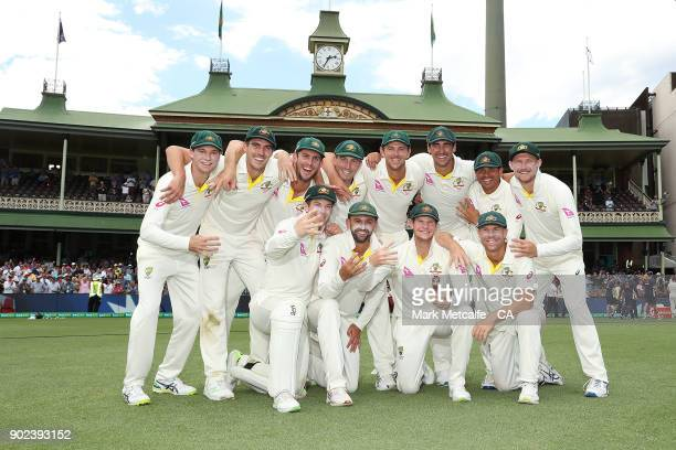 The Australian team celebrate winning the Ashes series with the Ashes trophy during day five of the Fifth Test match in the 2017/18 Ashes Series...