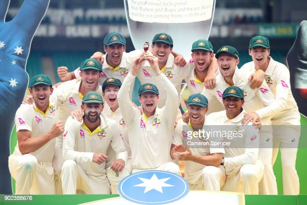 The Australian team celebrate winning the Ashes series with the trophy during day five of the Fifth Test match in the 2017/18 Ashes Series between...