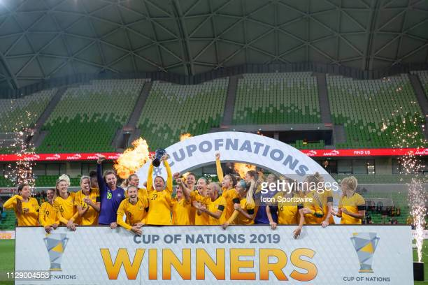 The Australian team celebrate with the cup after winning the match during The Cup of Nations womens soccer match between Australia and Argentina on...
