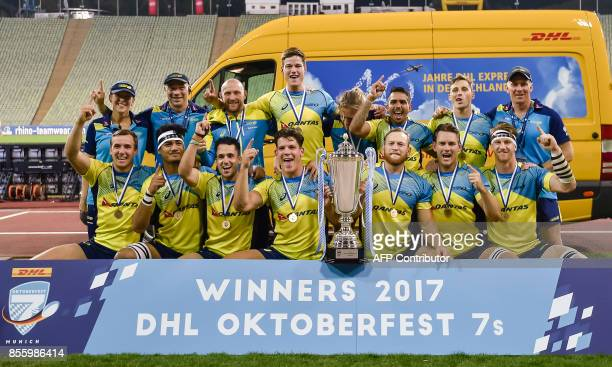 The Australian team celebrate with the trophy after the final match Fiji vs Australia at the Rugby Oktoberfest7s in Munich southern Germany on...
