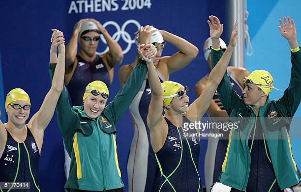 The Australian team celebrates winning gold in the women's 4 x 100 metre freestyle relay final on August 14, 2004 during the Athens 2004 Summer...