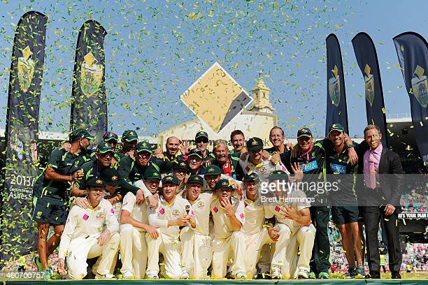The Australian team coaching staff and management celebrate with the urn after winning the Ashes series 50 during day three of the Fifth Ashes Test...
