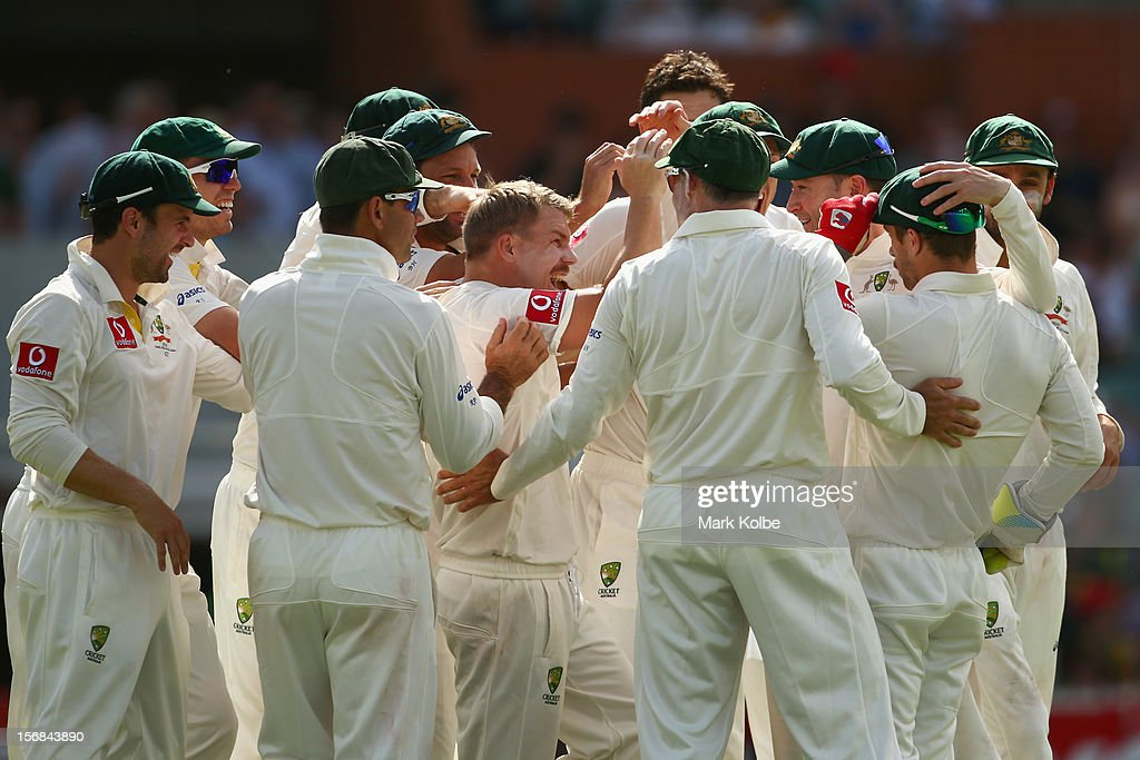 The Australian team congratulate David Warner and Matthew Wade of Australia after they combined to take the wicket of Hashim Amla of South Africa during day two of the Second Test match between Australia and South Africa at Adelaide Oval on November 23, 2012 in Adelaide, Australia.