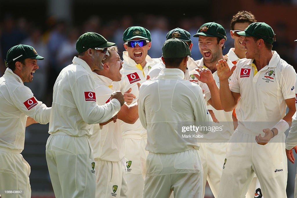 The Australian team congratulate David Warner of Australia after he combined with Matthew Wade of Australia to take the wicket of Hashim Amla of South Africa during day two of the Second Test match between Australia and South Africa at Adelaide Oval on November 23, 2012 in Adelaide, Australia.