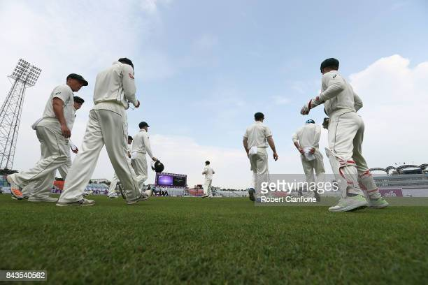 The Australian team enter the field for the second innings during day four of the Second Test match between Bangladesh and Australia at Zahur Ahmed...