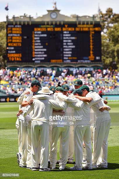 The Australian team form a huddle prior to play during day one of the Third Test match between Australia and South Africa at Adelaide Oval on...