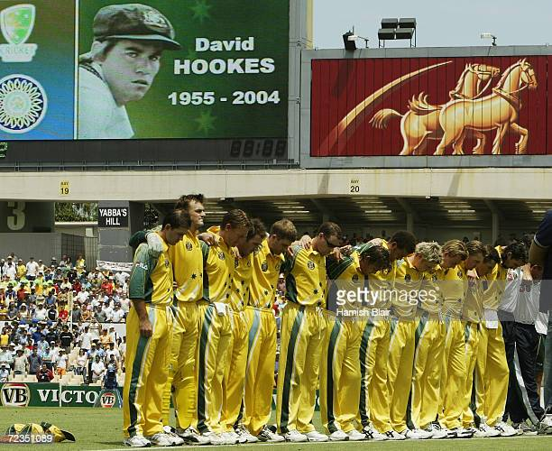 The Australian Team have a minute's silence for the late former Australian Cricketer David Hookes before the VB Series One Day International between...