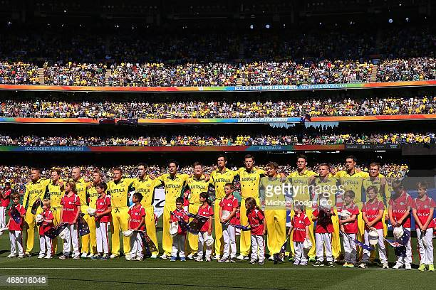 The Australian team lines up for their National Anthems during the 2015 ICC Cricket World Cup final match between Australia and New Zealand at...