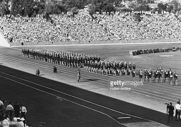 The Australian team marches past during the opening ceremony of the British Empire and Commonwealth Games Perth Australia 22nd November 1962