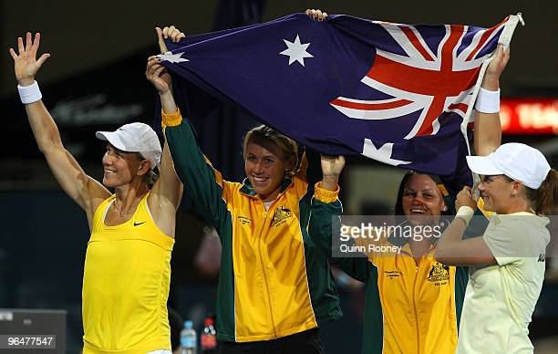 The Australian team of Rennae Stubbs Alicia Molik Casey Dellacqua and Sam Stosur celebrate winning their 2010 Fed Cup World Group II tie between...