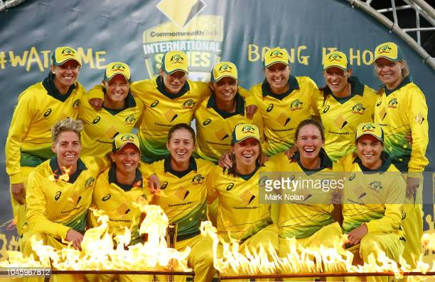 The Australian team pose after winning game three of the Twenty20 series between Australia and New Zealand at Manuka Oval on October 5 2018 in...