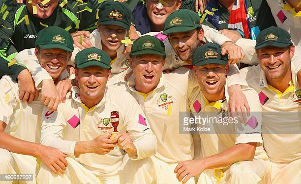 The Australian team pose as they celebrate with the urn after winning the test and the series 5 0 during day three of the Fifth Ashes Test match...